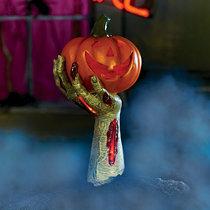 zombie arm holding pumpkin lantern outdoor halloween decoration